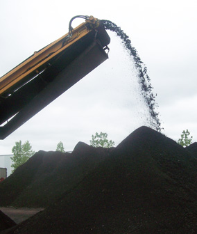 Using recycled asphalt shingles in asphalt pavements