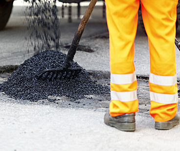 Preventing and repairing potholes and pavement cracks